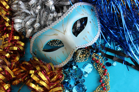 trumpery: Blue carnival mask on a blue background with festive decorations