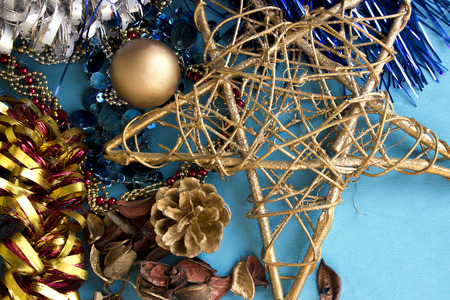 trumpery: Christmas composition with shiny decorations on a blue background