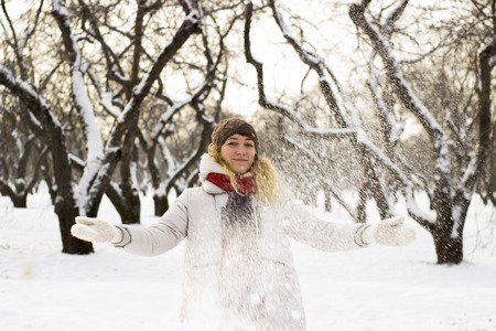 fell: Soft and blur conception.Young beautiful girl close up in winter park enjoys snow fell Stock Photo