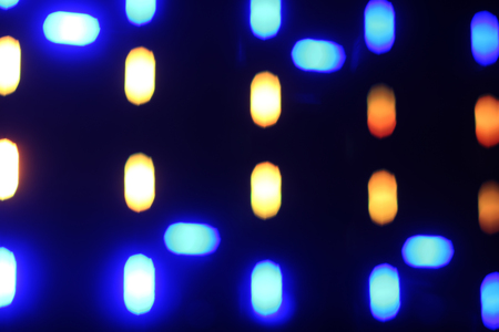 Beautiful multi-colored reflections in the form of glowing bokeh night lights.
