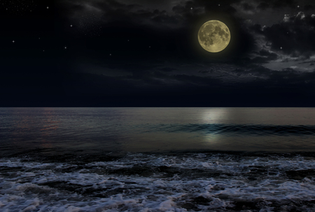 reflexion: Beautiful magic blue night sky with clouds and full moon and stars and reflexion in water. Stock Photo
