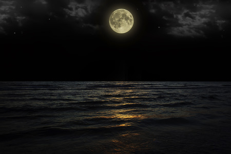 reflexion: Beautiful magic blue night sky with clouds and full moon stars reflexion in water.