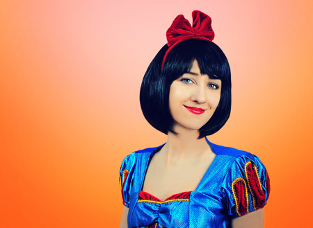 Cosplay of Snow White on the pink-orange background. Artistic processing