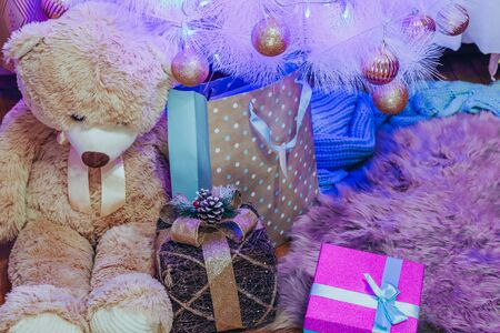 Decorated Christmas tree with gift under it and teddy bear. Stok Fotoğraf