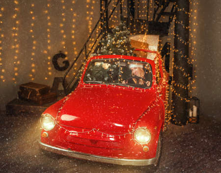 Santa woman in red festive car with fir tree and the gifts inside