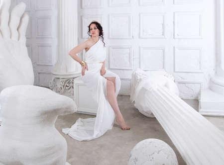 Beautiful Greek goddess woman close up among the white ancient ruins Stok Fotoğraf