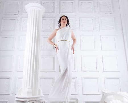 Beautiful Greek goddess woman close up among the white ancient ruins. Stok Fotoğraf