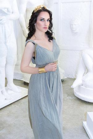 Beautiful Greek goddess woman close up on the white background.Greek style woman. Stok Fotoğraf