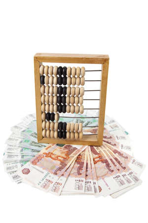 wooden scores and russian money on  white background photo