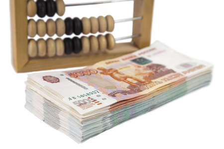 wooden scores and русие money on  white background photo