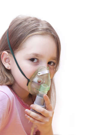 asthma: girl makes inhalation on a white background