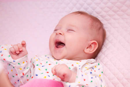 the little girl cheerfully smiles photo
