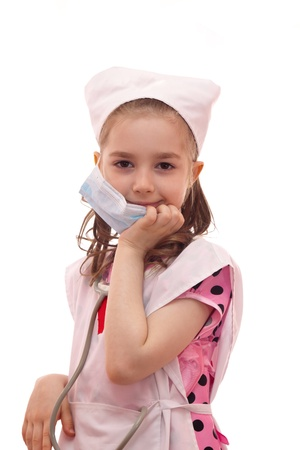 girl in the dress of a doctor on a white background photo