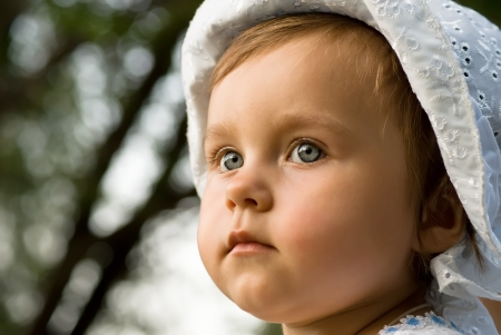 Closeup of adorable little girl in thought