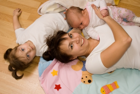 Little children with Mommy Stock Photo