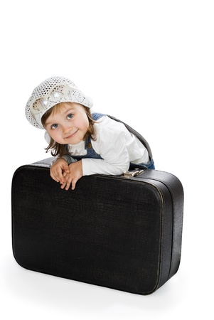 Smiling pretty little girl with suitcase isolated on white Stock Photo