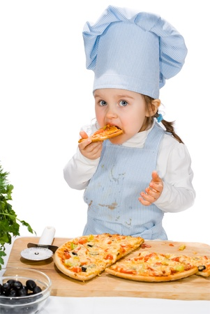 little girl eating a pizza with salami and vegetables
