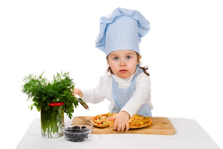 little girl with cutter and pizza Stock Photo