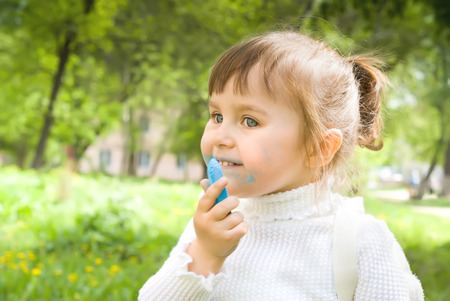 hellion: Cute little girl with blue chalk outdoors