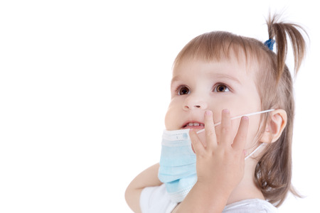 Portrait of little girl with surgical face mask for bacterial and virus flu protection on white background Stock Photo