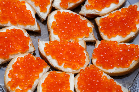 celebratory: Sandwiches with butter and red salmon caviar. Celebratory appetizer. Stock Photo