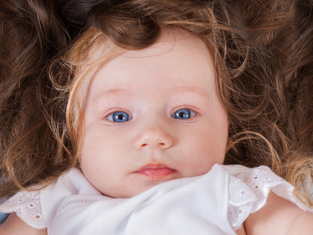 Cute little girl over mommy hair, funny image