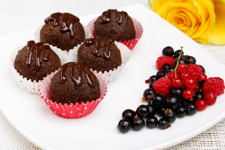 A delicious dessert with chocolate cupcakes and fresh berries