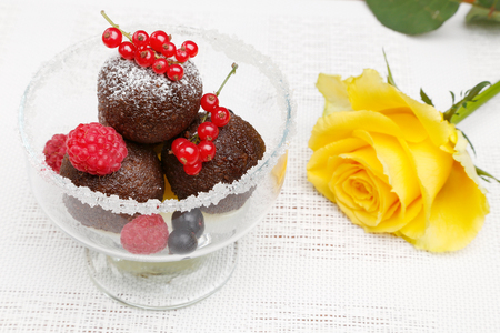 A delicious dessert with chocolate cake balls and fresh berries