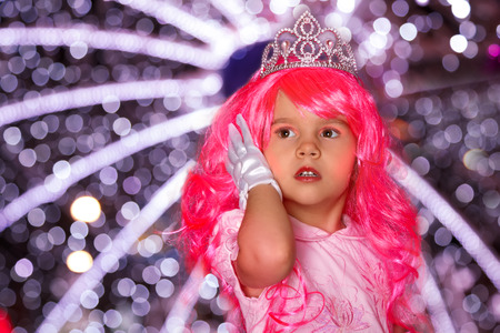Beautiful little girl as a princess with pink hair
