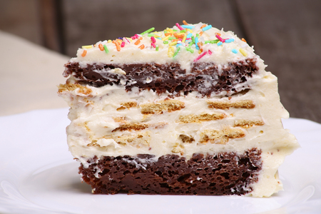 Piece of homemade chocolate cake with butter cream Stock Photo