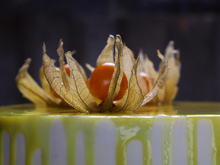 decoration with a yellow glaze and physalis berries on the top for a cake