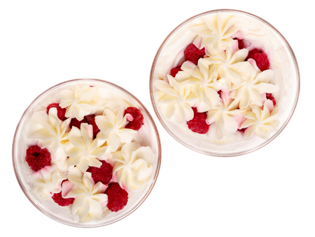 sweet cream dessert with raspberries, isolated on a white background, top view