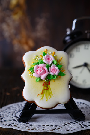 homemade gingerbread cookie with the handmade icing flowers decoration