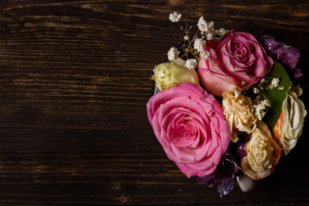 dark wooden background with withered flowers, autumn, end of summer