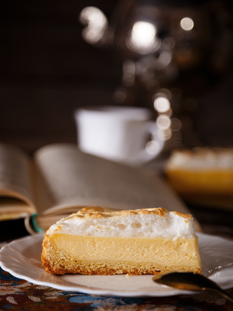 Piece of sweet cottage cheese dessert, covered with delicate souffle, tea concept