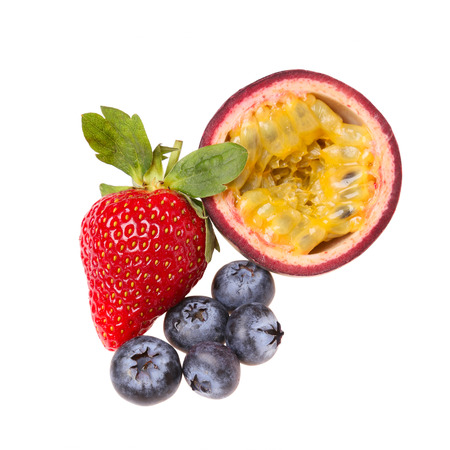 Fruits isolated on white background, strawberry, blueberry, and passion fruit