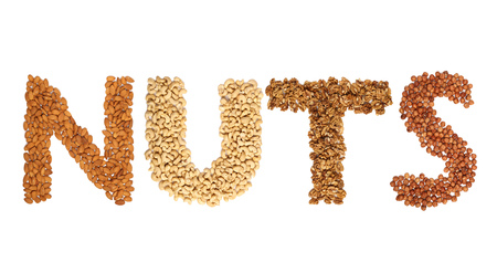 Word Nuts with letters made from different whole nuts on a white background Banco de Imagens