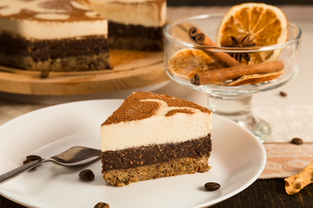 Slice of Tiramisu raw cake. Raw cakes are cakes and pastries that are not exposed to heat and chemical processing. This is an excellent substitute for sweets and made from only natural products.