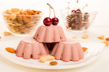 Cherry Raw Dessert. Raw cakes are cakes and pastries that are not exposed to heat and chemical processing. This is an excellent substitute for sweets and made from only natural products.