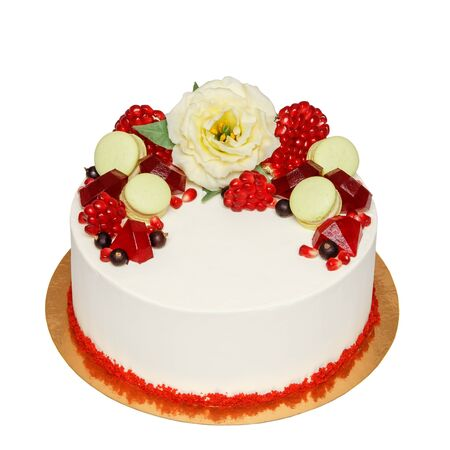 Red velvet cake with chocolate flower decoration pomegranate and macaroons isolated on white