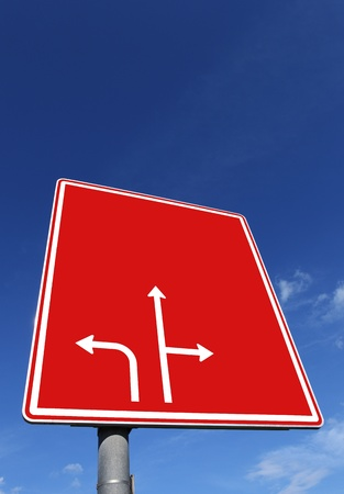 roadsign: roadsign in red with directional arrows Stock Photo