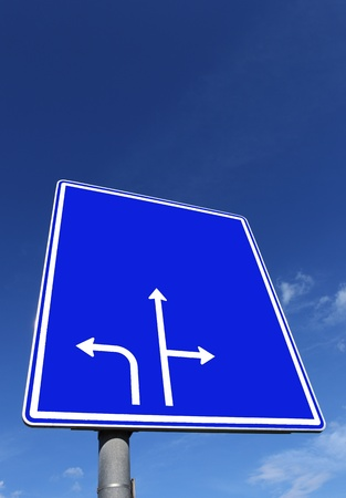 roadsign in blue with directional arrows photo
