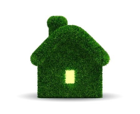 Grassed house which light in window  Stock Photo
