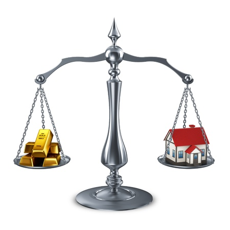 goldbars: balance scale with house and goldbars  Stock Photo