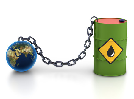 Barrel of oil and earth. Stock Photo