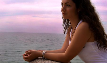 The beautiful brunette on a beach of the black sea photo