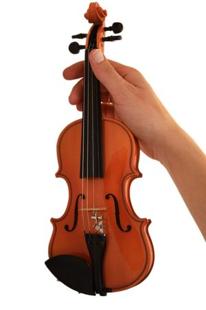 Small violin in a hand. A white background, it is isolated Stock Photo - 2200685