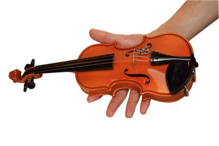 Small violin in a hand. A white background photo