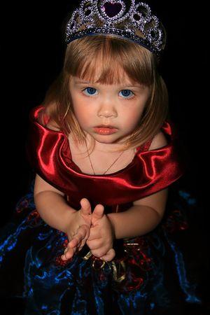 velvet dress: The girl in a beautiful velvet dress. A black background