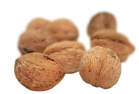 good cholesterol: Walnuts in a peel. It is isolated on a white background